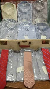 packages of shirts and ties